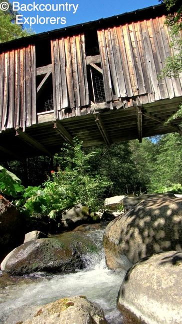 Looking up at Oregon Creek covered bridge from the creek.