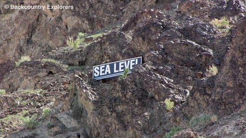 Sea level sign on side of the mountain