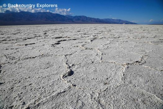 Bawater salt flats with mountains in background