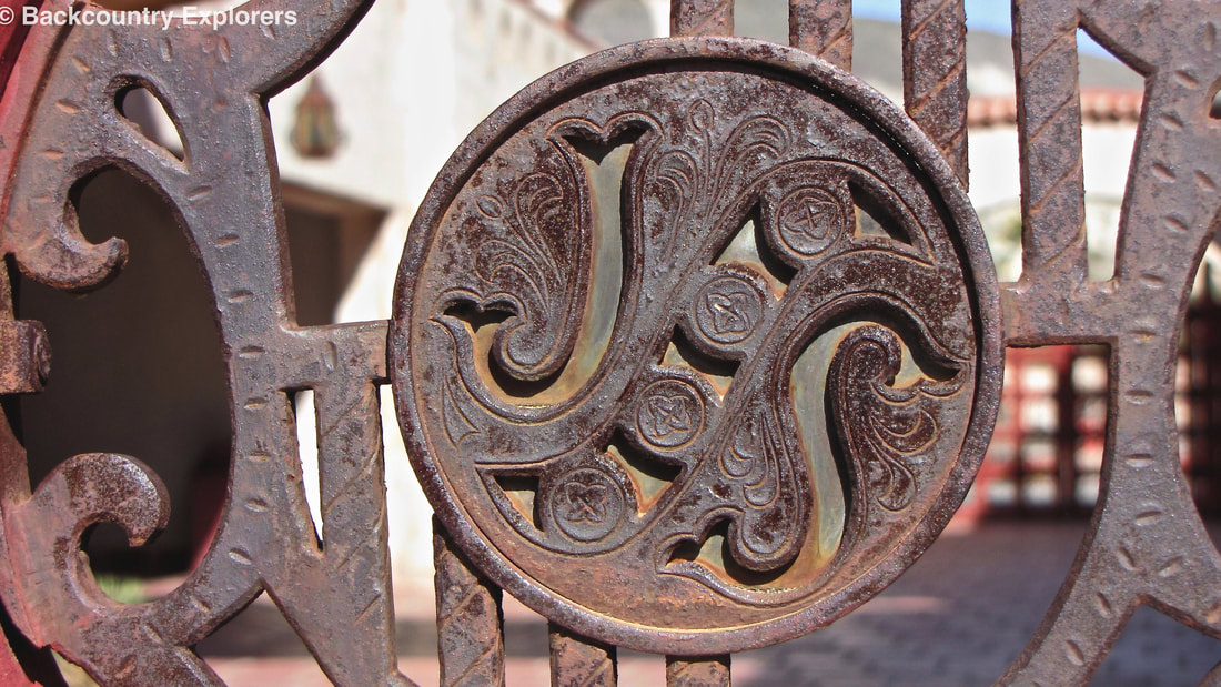 Owners initials on court yard gate
