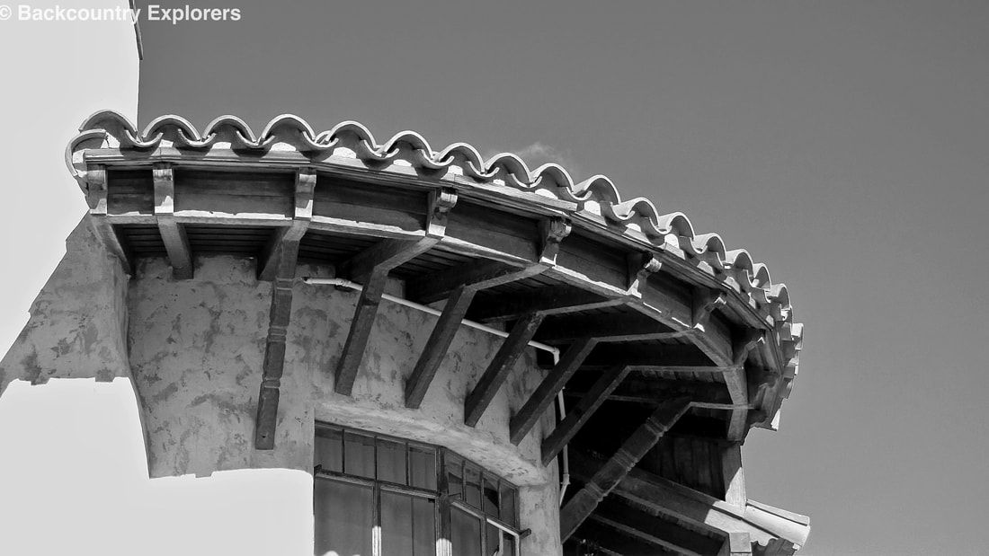 Curved tile roofline in black and white.